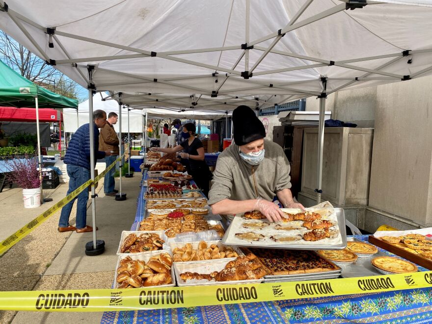 A vendor lays out pastries at a stall in the Dupont Circle Market in Washington, D.C. A number of small business owners have been dealing with delays, confusion and frustration trying to access the loans that are part of the $2 trillion relief package that Congress passed last month.