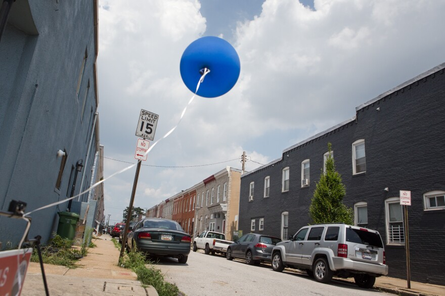 A balloon advertises an open house on a street in McElderry Park in Baltimore.