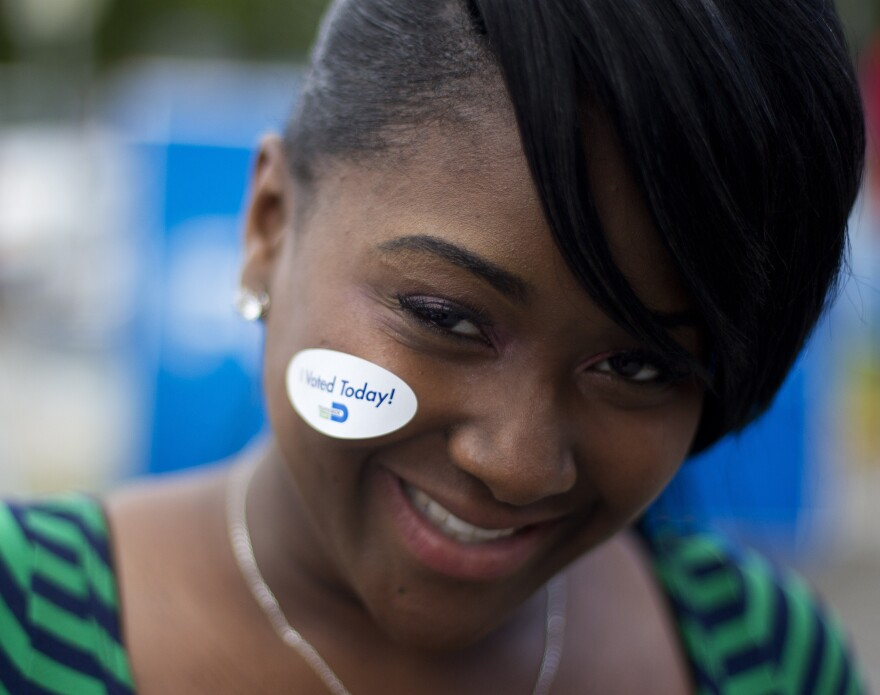 "A young Miami voter wears her ""I voted today"" sticker in October 2012."