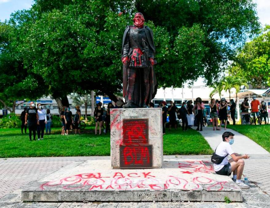 A view of the Juan Ponce de Leon statue near the Torch of Friendship in downtown Miami days after it was vandalized during a Black Lives Matter protest on Wednesday, June 10, 2020.