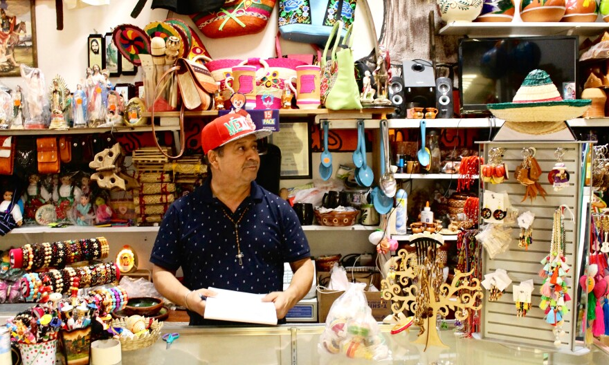 Armando Farias, 56, tends to his small shop filled with Mexican goods at Plaza Garland.