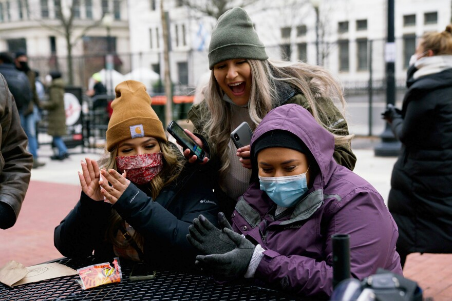 Ariana Avalos, 24, stands behind sisters Cynthia Cortez, 21, left, and Teresa Cortez, 19, in downtown Washington, D.C. All three came from California to watch the inauguration.