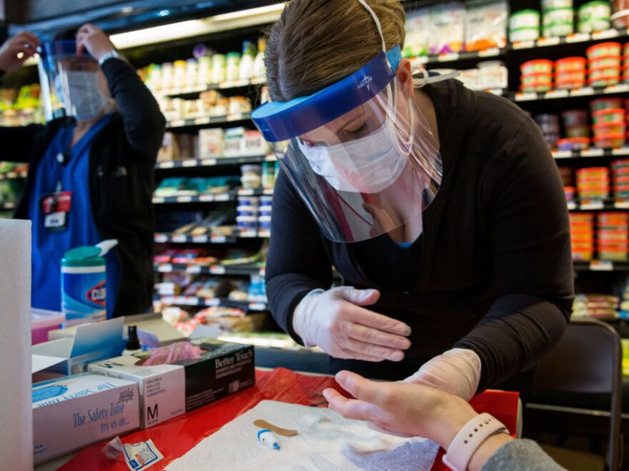 A COVID-19 antibody testing center is seen at Steve's 9th Street Market in Brooklyn on April 25. Here's a quick guide to sorting out the pluses and minuses to each type of test.
