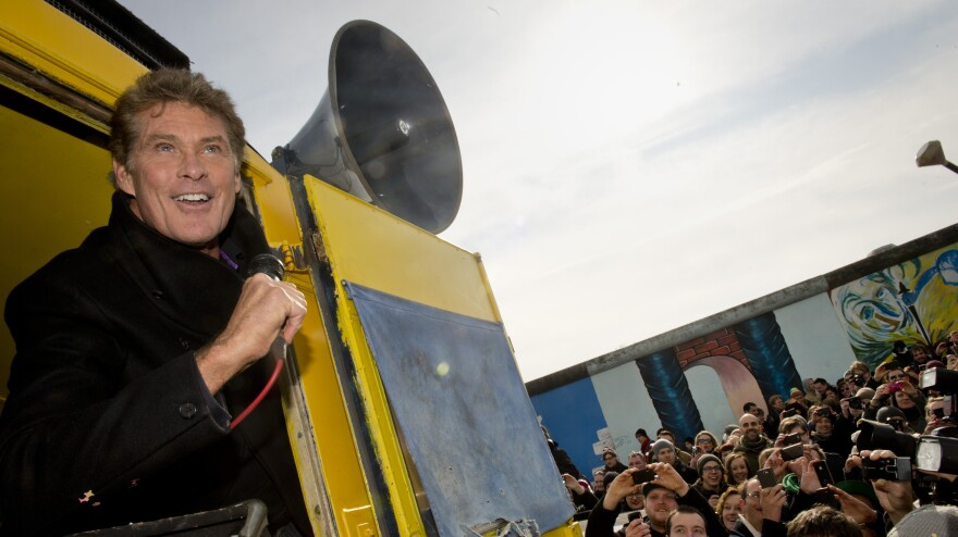 American actor David Hasselhoff speaks to protesters next to a remnant of the Berlin Wall last week. Thousands of people turned out to oppose a plan to knock down one of the few remaining sections of the wall. A small part was removed Wednesday.