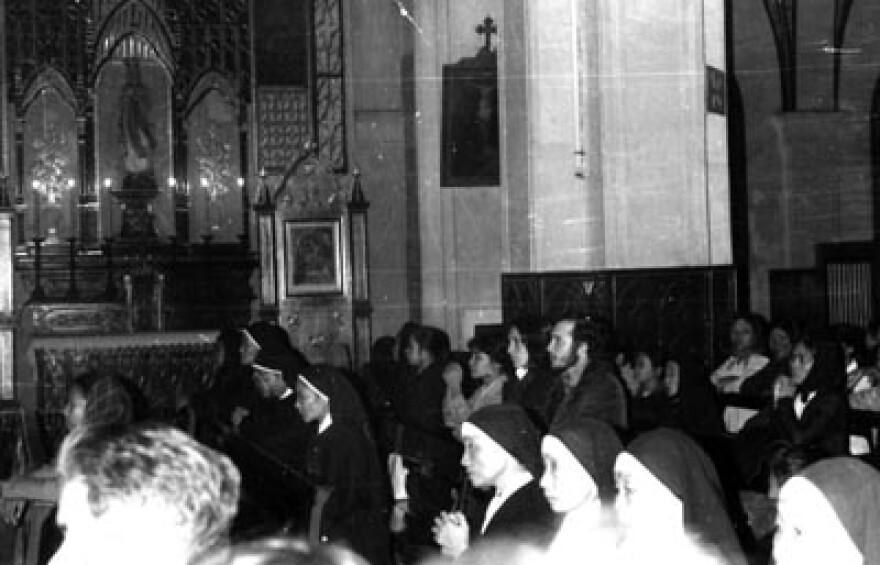 Joan Baez and Barry Romo attending mass in Hanoi during the Christmas Bombings.