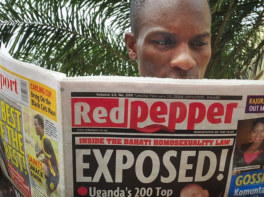 A man reads a copy of <em>Red Pepper</em> on Tuesday in Kampala, Uganda.