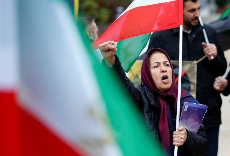 A protester chants slogans against the Iranian government outside the European Union Council in Brussels, Belgium on Wednesday.