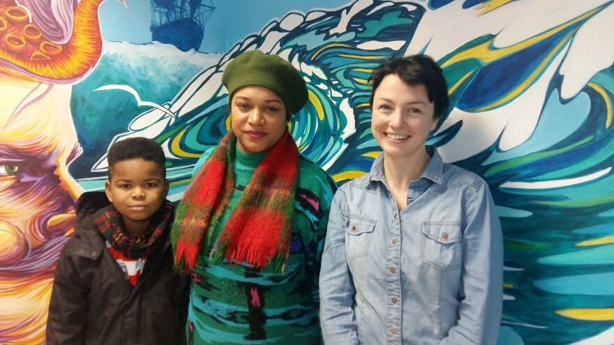 Katie Finnegan-Clarke (right) and Cleo Lake (center), standing with Lake's son, help run Countering Colston, an activist group lobbying for Edward Colston's name to be removed from city streets, schools and landmarks.