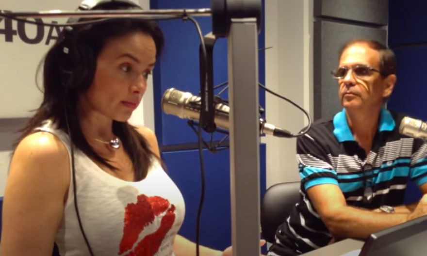 RACIST RANTS Venezuelan expat radio host Carines Moncada (left) on the air in Miami with her Actualidad Radio co-host Augustin Acosta