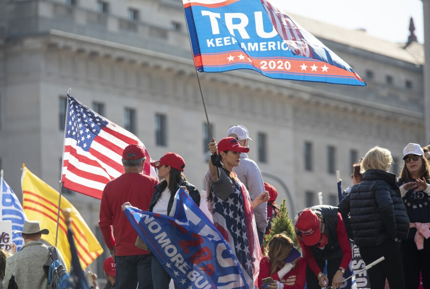Trump supporters brought campaign flags but not many masks to the Washington, D.C., demonstrations on Saturday.
