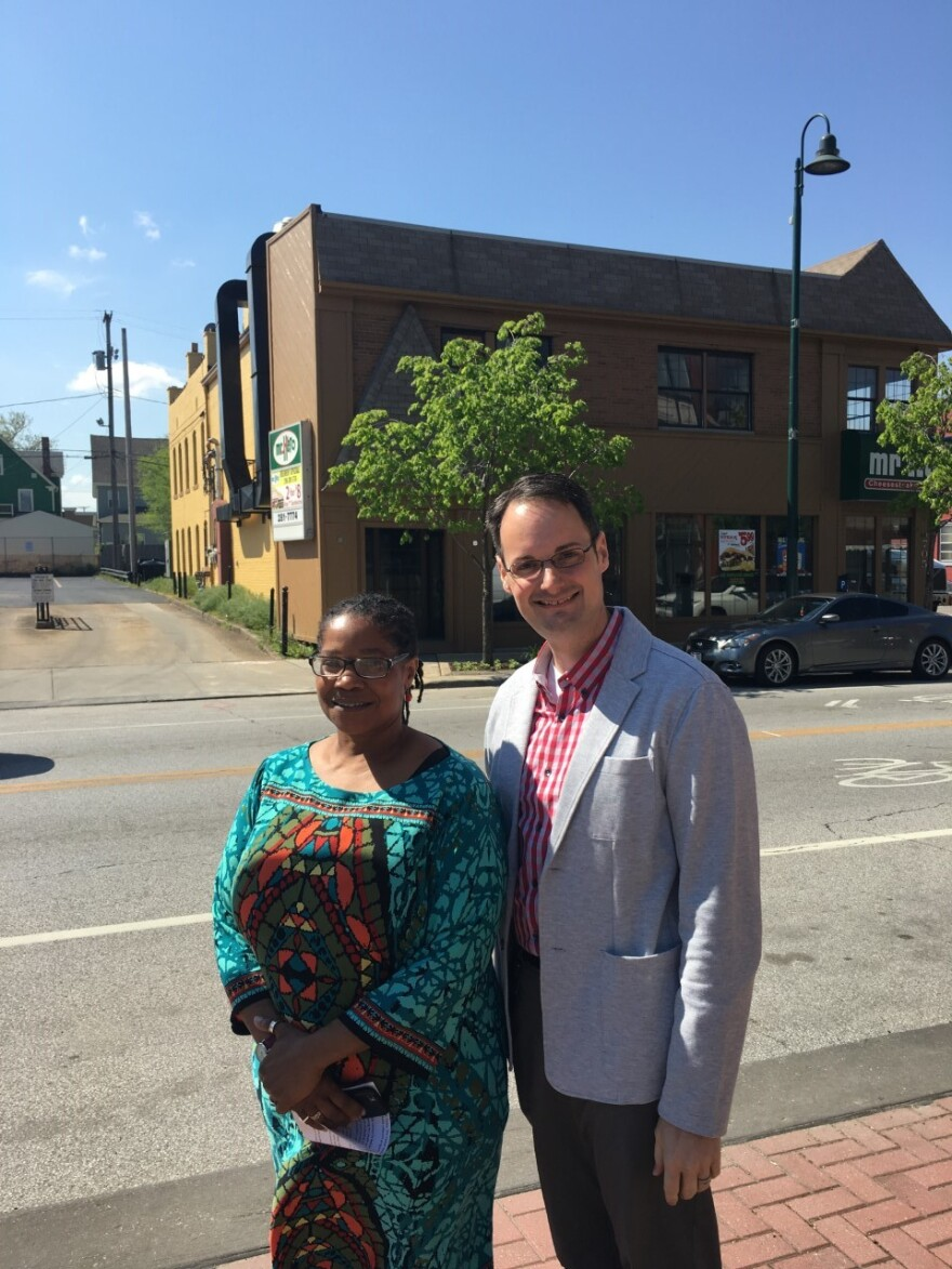 Cleveland LGBT Center Executive Director Phyllis Harris and Board President Bryan Bowser in front of the Detroit Avenue building that will be razed to make room for the new center.