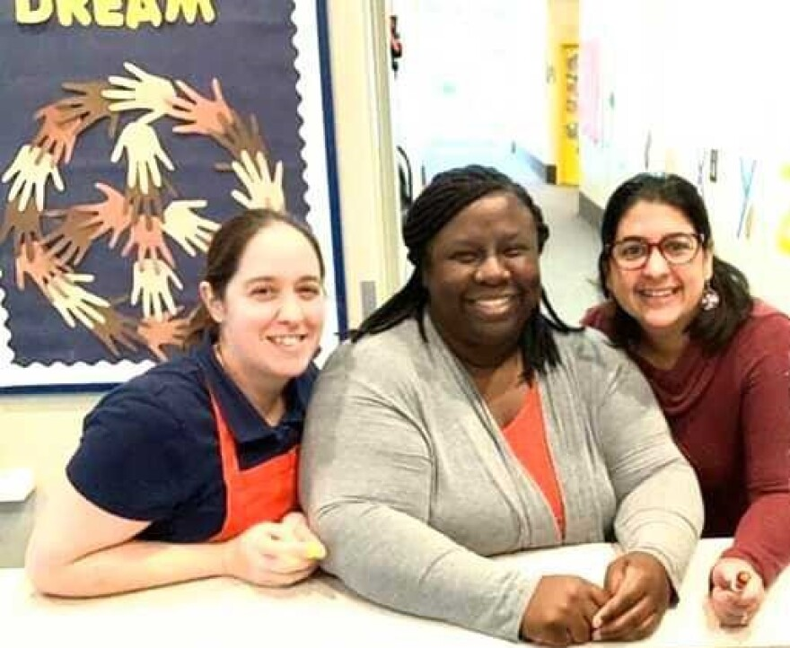 Michelle Eonta, LeKeshia Liles and Adrianne Valdivia Gonzalez are co-workers at a childcare center in North Carolina.