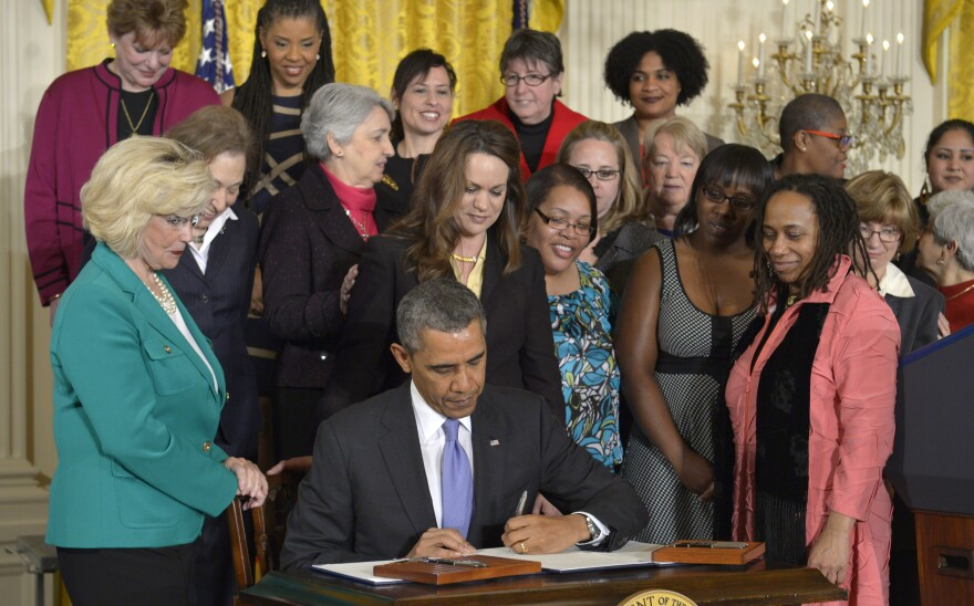 "President Obama signs two executive actions aimed at closing the gender pay gap, including an order to combat ""pay secrecy,"" on April 8."
