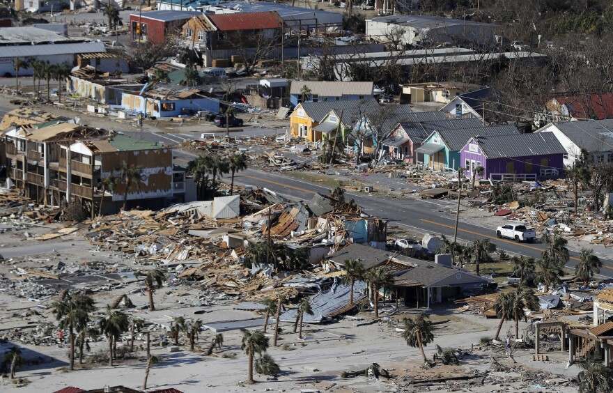 FILE - In this Oct. 12, 2018 file photo debris from homes destroyed by Hurricane Michael litters the ground in Mexico Beach, Fla. Michael was among the strongest hurricanes ever to make landfall in the United States. (AP Photo/Gerald Herbert, File)