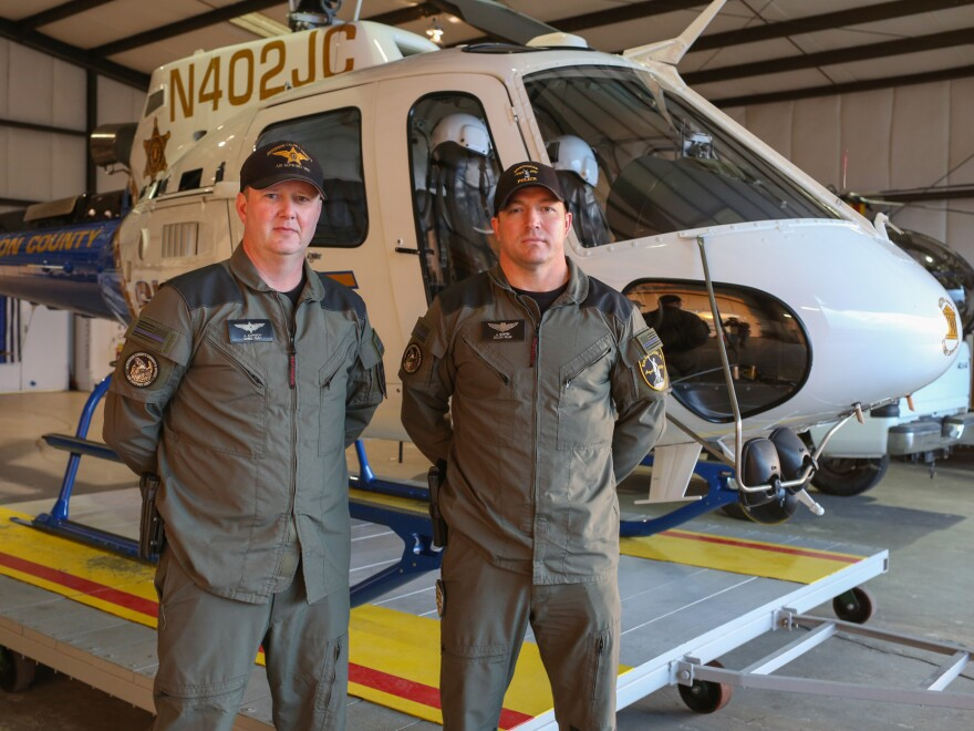 "Pilot Jonathan Johnson (L) said the VR technology was ""like no other [training] flight I've flown."" PIlot Jerry Griffin (R) said, ""it doesn't get any realer than that."""