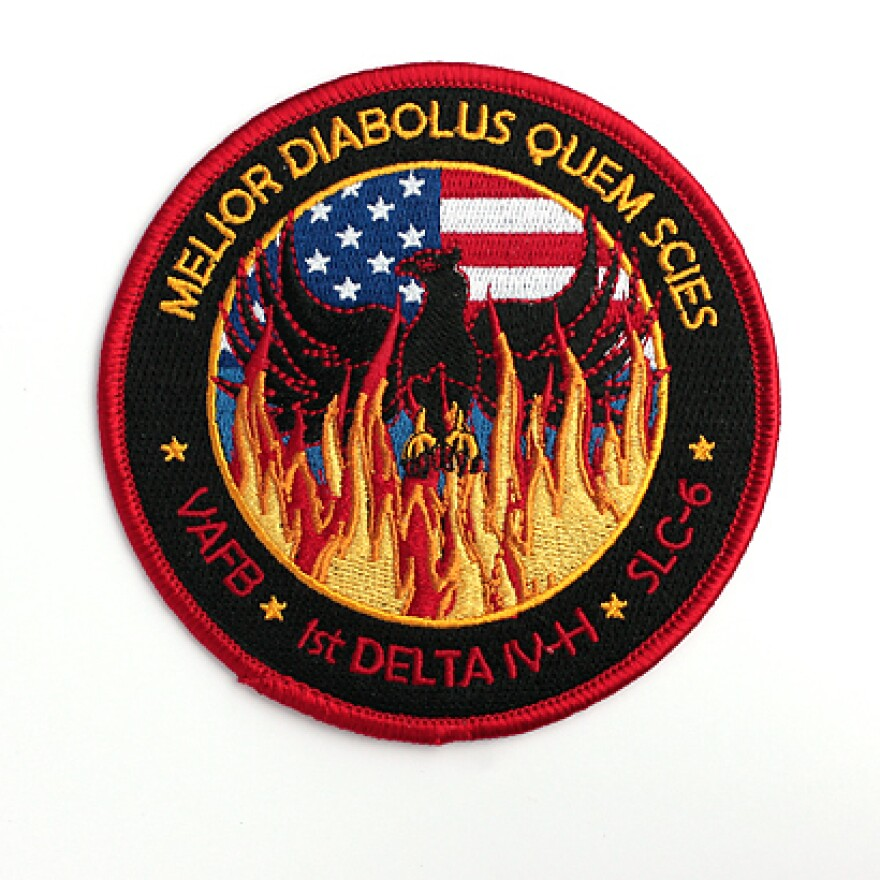 """The mission patch for the USA 224/NROL-49 satellite includes the Latin phrase """"better the devil you know."""""""