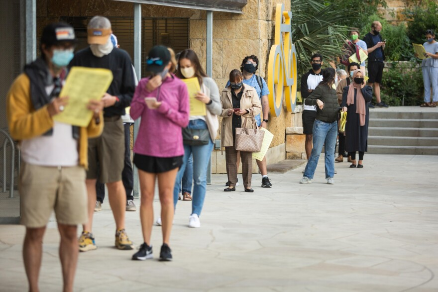 Travis County residents vote at Austin Central Library during early voting.