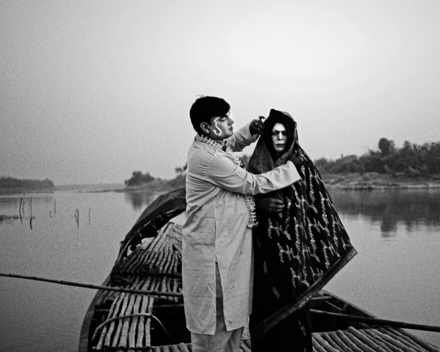 Anukul Ghosh (left), 63, and Rabin Kumar Majhi, 51, pose as a newly married couple. Ghosh used to play female characters in the 1970s and 1980s. He has now retired from Jatra.