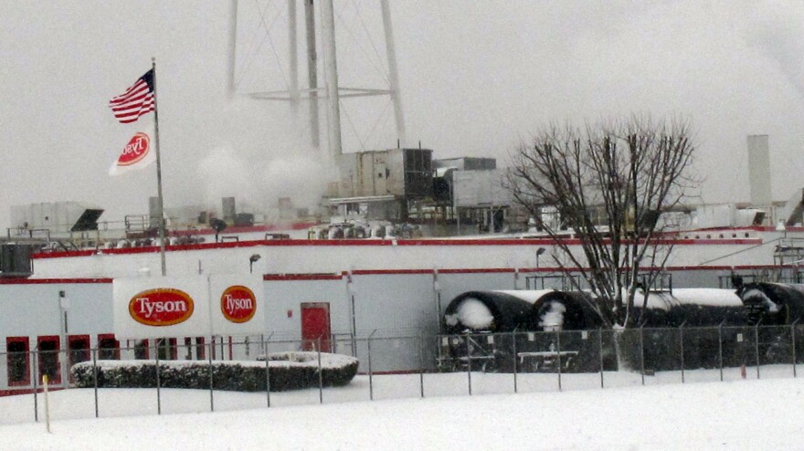 Tyson Foods says it has suspended operations at its pork plant in Columbus Junction, Iowa, pictured in February 2013, after more than two dozen workers got sick with COVID-19.