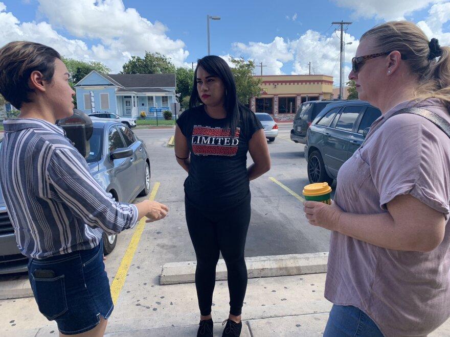 Dani Marrero Hi (left) with the Texas Civil Rights Project and attornery Jodi Goodwin (right) talk to Mayela, who is seeking asylum into the U.S.