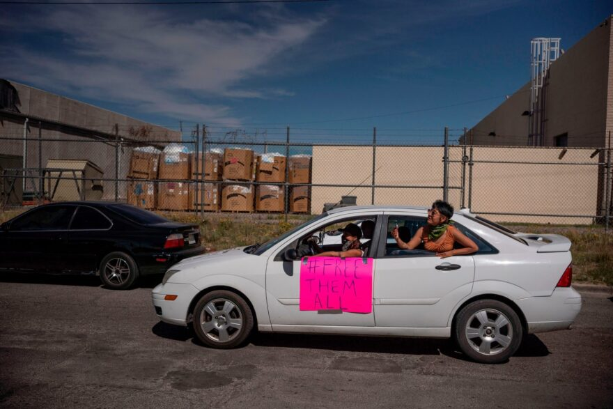 Protesters drive in a caravan around an Immigration and Customs Enforcement Processing Center to demand the release of detainees due to safety concerns amidst the COVID-19 outbreak.