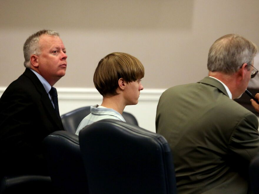 Dylann Roof appears with lawyers Bill McGuire and Chief Public Defender Ashley Pennington at a court hearing in Charleston, S.C., on July 16, 2015.