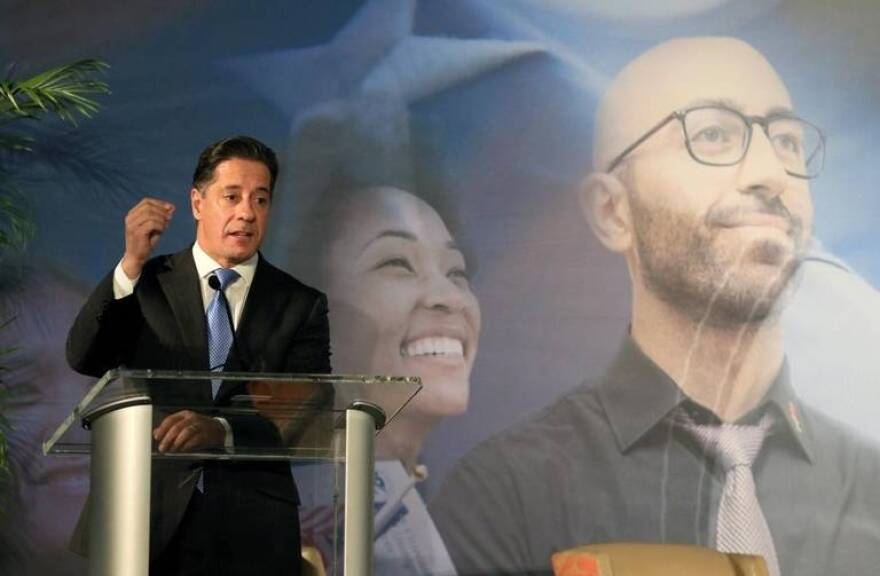 Alberto Carvalho, superintendent of Miami-Dade County Public Schools, speaks to business and political leaders gathered at the University of Miami for a Tuesday summit on immigration reform.
