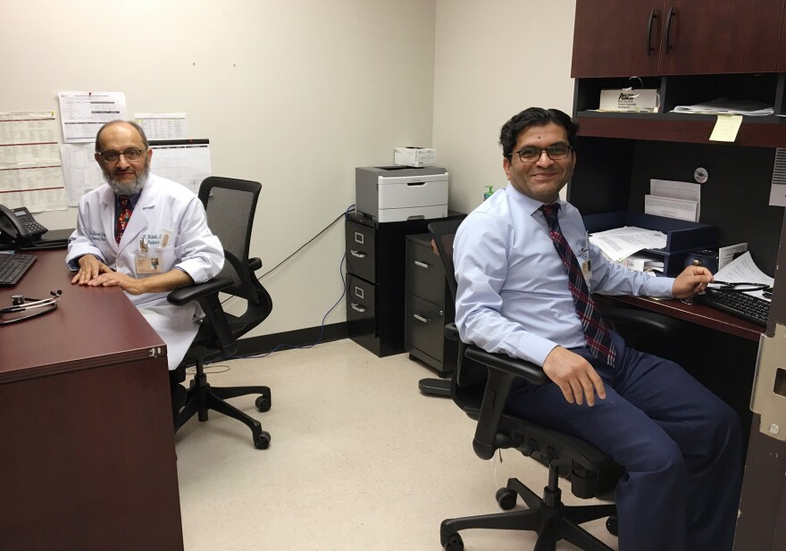 Dr. Farooq Habib (left) and Dr. Muhammad Tauseef share an office at Los Barrios Unidos Community Clinic in Dallas. They're both from Pakistan and have both worked as pediatricians in medically underserved areas in the U.S.