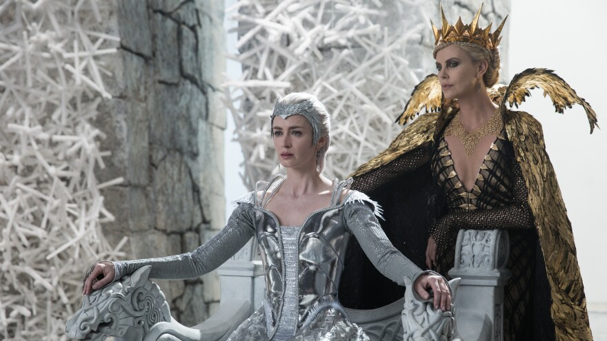 Queen Freya (Emily Blunt) and Queen Ravenna (Charlize Theron) in the story that came before Snow White: <em>The Huntsman: Winter's War</em>.