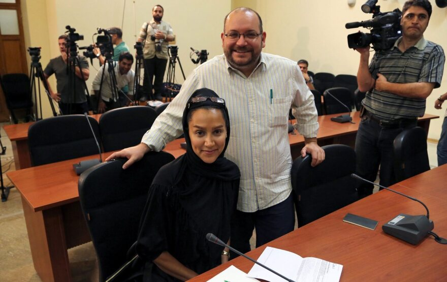 """<em>Washington Post</em> Iranian-American journalist Jason Rezaian, seen here with his wife, Yeganeh Salehi, has been held prisoner since he was arrested in Tehran last July. On Thursday, a powerful Iranian politician said of a potential prisoner swap, """"That's one way."""""""