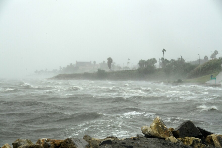 Strong winds batter seaside houses from the approaching Hurricane Harvey in Corpus Christi on Friday.