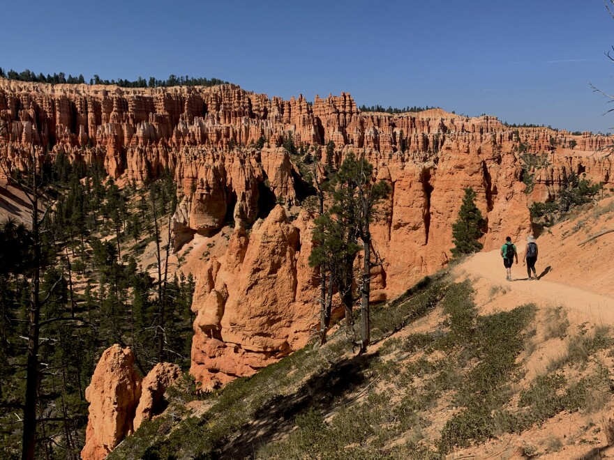 Photo of two hikers at Bryce Canyon National Park.