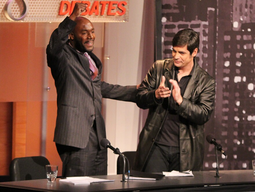 Paul Butler (left) and Nick Gillespie celebrate their victory in an <em>Intelligence Squared U.S.</em> debate. They argued in favor of legalizing drugs.