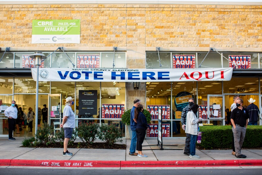 Travis County residents line up to vote at the Southpark Meadows shopping center on the first day of early voting.