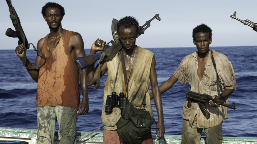 Barkhad Abdi (center) learned to swim, navigate small skiff boats, handle weapons — and act — for the film <em>Captain Phillips.</em>