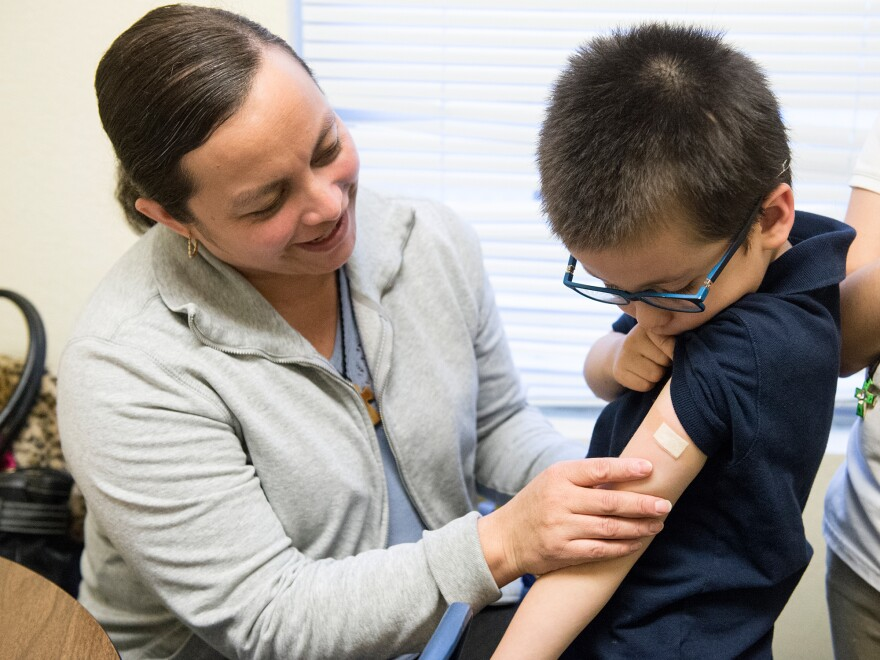 Luz Barajas took her son Carlos Cholico to get his flu shot at Crawford Kids Clinic in Aurora, Colo., last year. Health officials say there is some evidence the flu shot is more protective than the nasal flu vaccine.