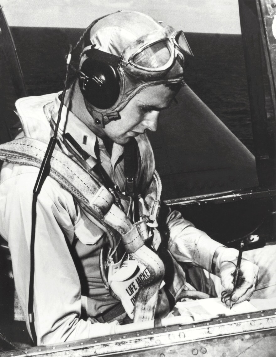 Bush, pictured in the cockpit of his TBM Avenger during World War II, enlisted in the Navy on his 18th birthday and became one of its youngest pilots.