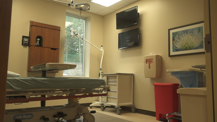Room with hospital bed and TV.