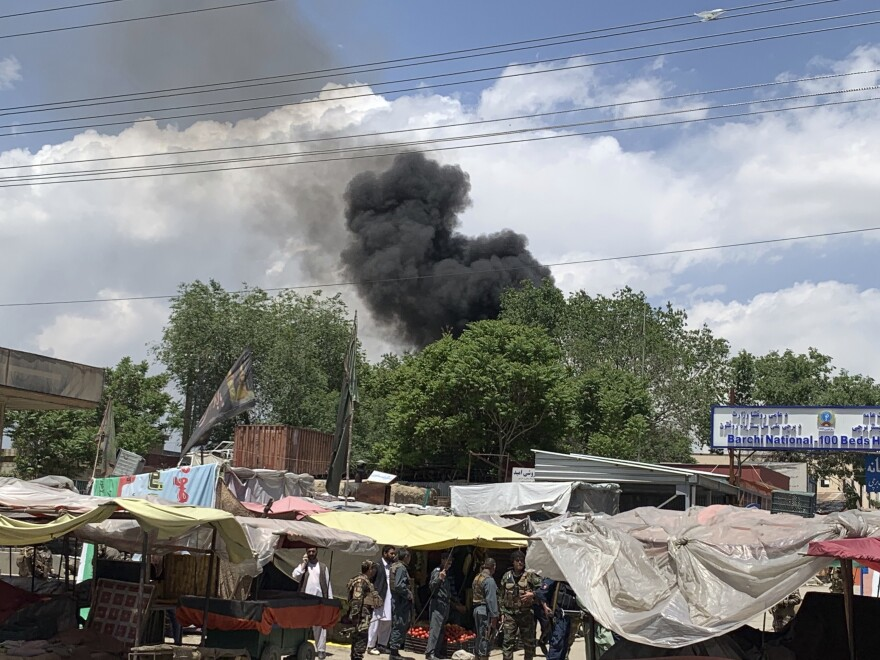 A plume of smoke can be spotted from a distance in Kabul after gunmen attacked a medical center Tuesday in the Afghan capital.