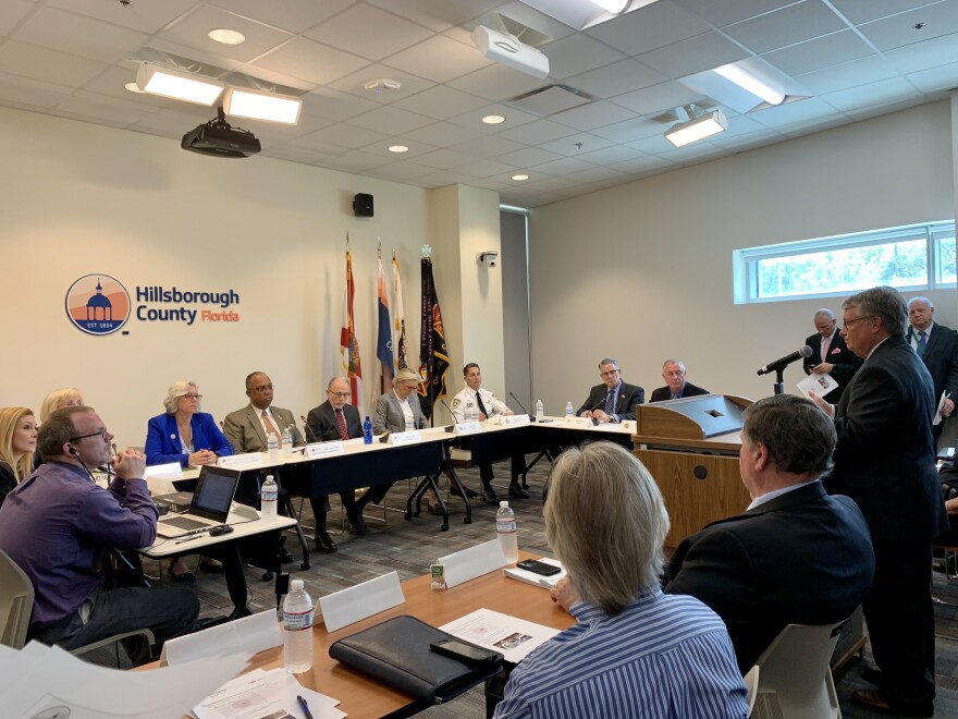 Dr. Douglas Holt with the Florida Department of Health in Hillsborough briefs county commissioners and local mayors on the coronavirus.