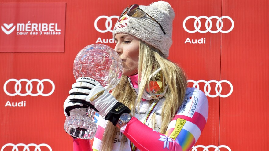 Vonn was a dominant force on the FIS World Cup circuit, where she won four World Cup overall championships. She's seen here kissing the crystal globe trophy after winning a Super-G race in Meribel, France, in 2015.