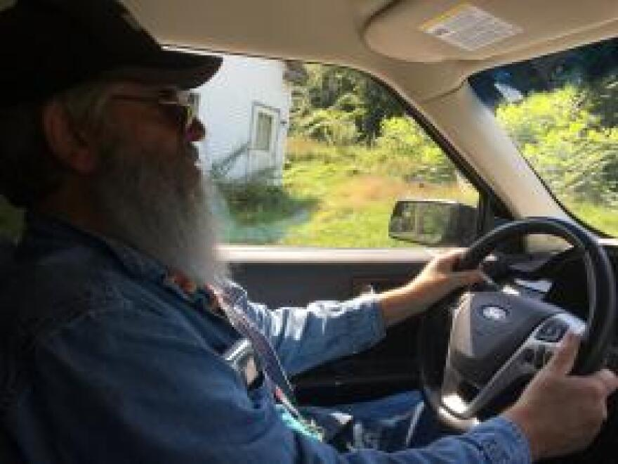 Jeff Snow drives through White River Junction, Vermont, after bringing veteran John Sherer home from his dialysis appointment.