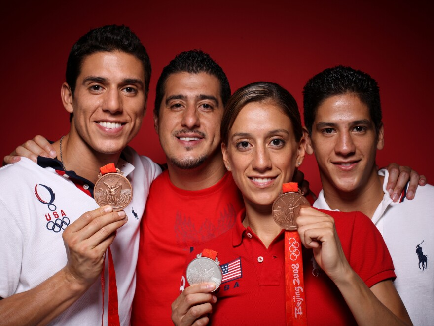 """Taekwondo athletes Steven (from left), Jean, Diana and Mark Lopez of the United States pose in the NBC <em>Today</em> show studio at the Beijing 2008 Olympic Games. The <em>Los Angeles Times</em> named them the """"first family of taekwondo."""""""