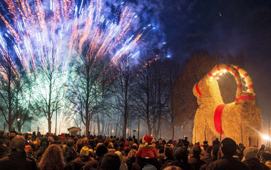 People look at fireworks during the inauguration of the traditional Gavle Goat on Nov. 29, 2015, in Gavle, Sweden.