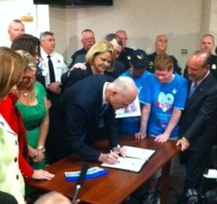 Scott signing the bills