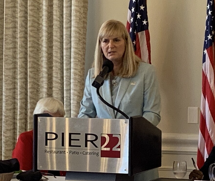 Dr. Carol Probstfeld speaks at a podium