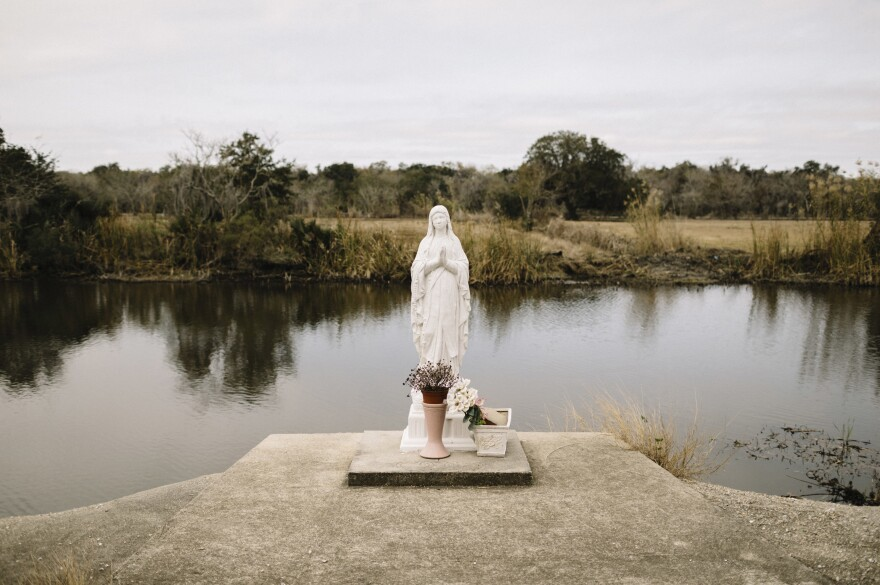 A statue of the Virgin Mary stands on the banks of Bayou Dularge in the tiny unincorporated fishing village of Theriot.