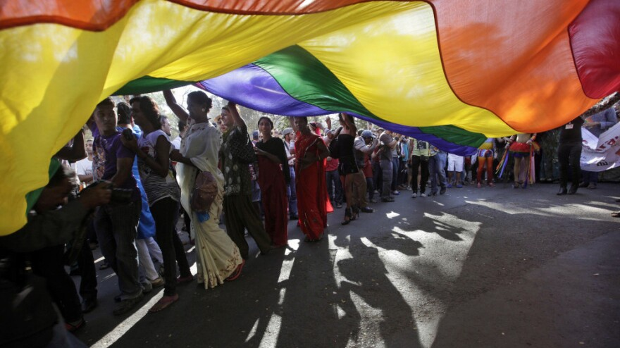 Participants carry a rainbow flag during a gay, lesbian, bisexual and transgender parade in Mumbai, India.