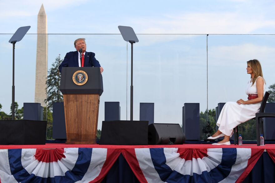 President Trump speaks on the South Lawn of the White House, accompanied by First Lady Melania Trump, on July 4. He'll deliver his main convention speech from the same location on Thursday.