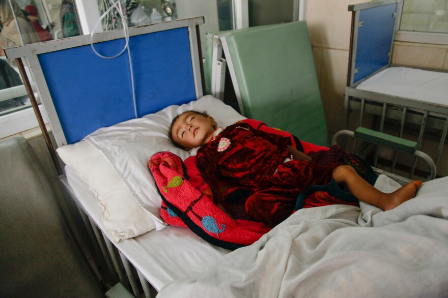 Parvana, 18 months old, lies on a gurney at a ward for malnourished children at the Indira Gandhi Children's Hospital in Kabul.